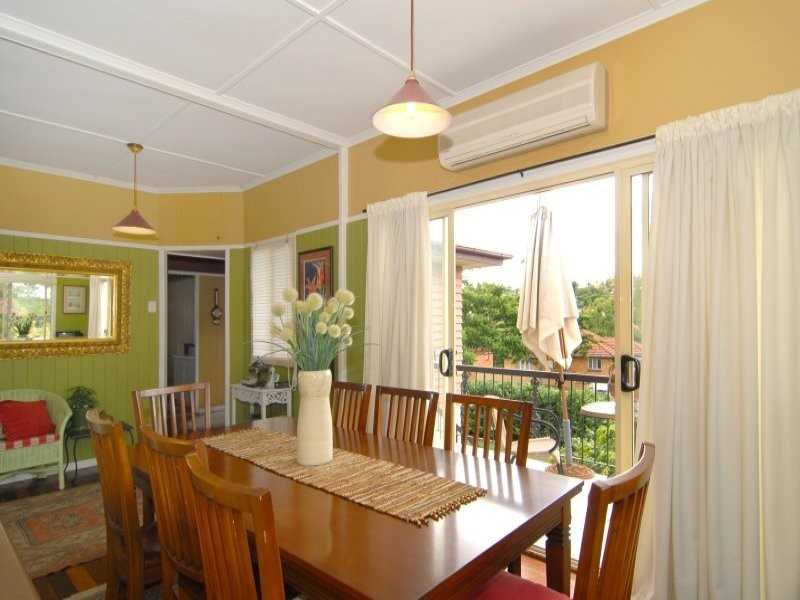 Dining Area Up Opens onto North Facing Deck
