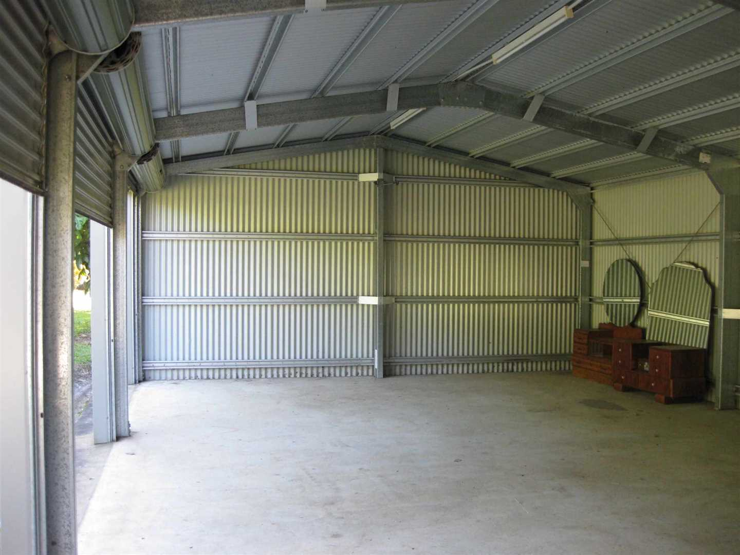 Inside view of part of three bay lockable shed, photo 1