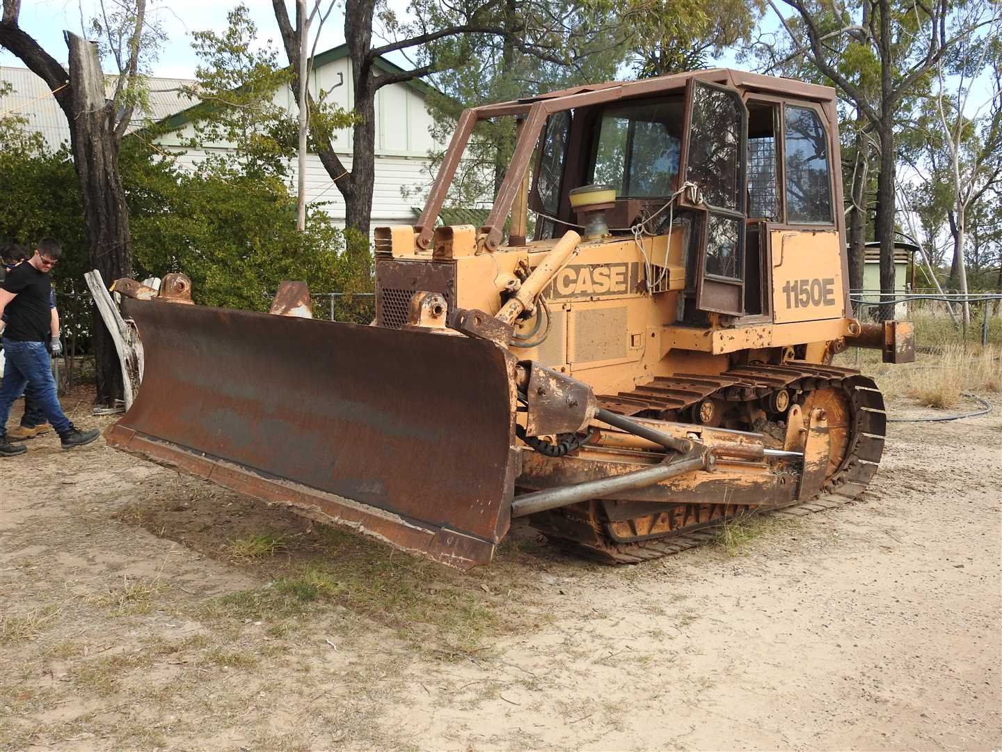 Case 1150E with tree pusher and single tyne ripper