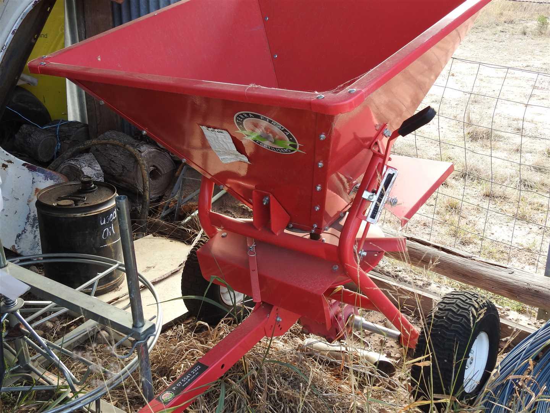 Trailing fertilizer spreader- new