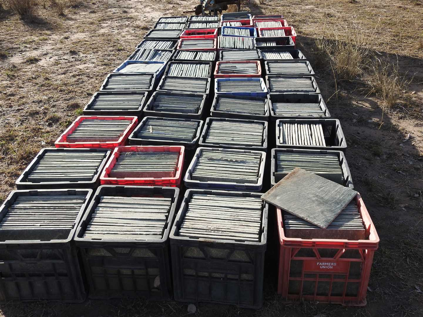 44 milk crates of slate tiles-300 x 300 all similar colour - grey/green. Ideal patio tiles . .  Approx 15- 20 in each box.