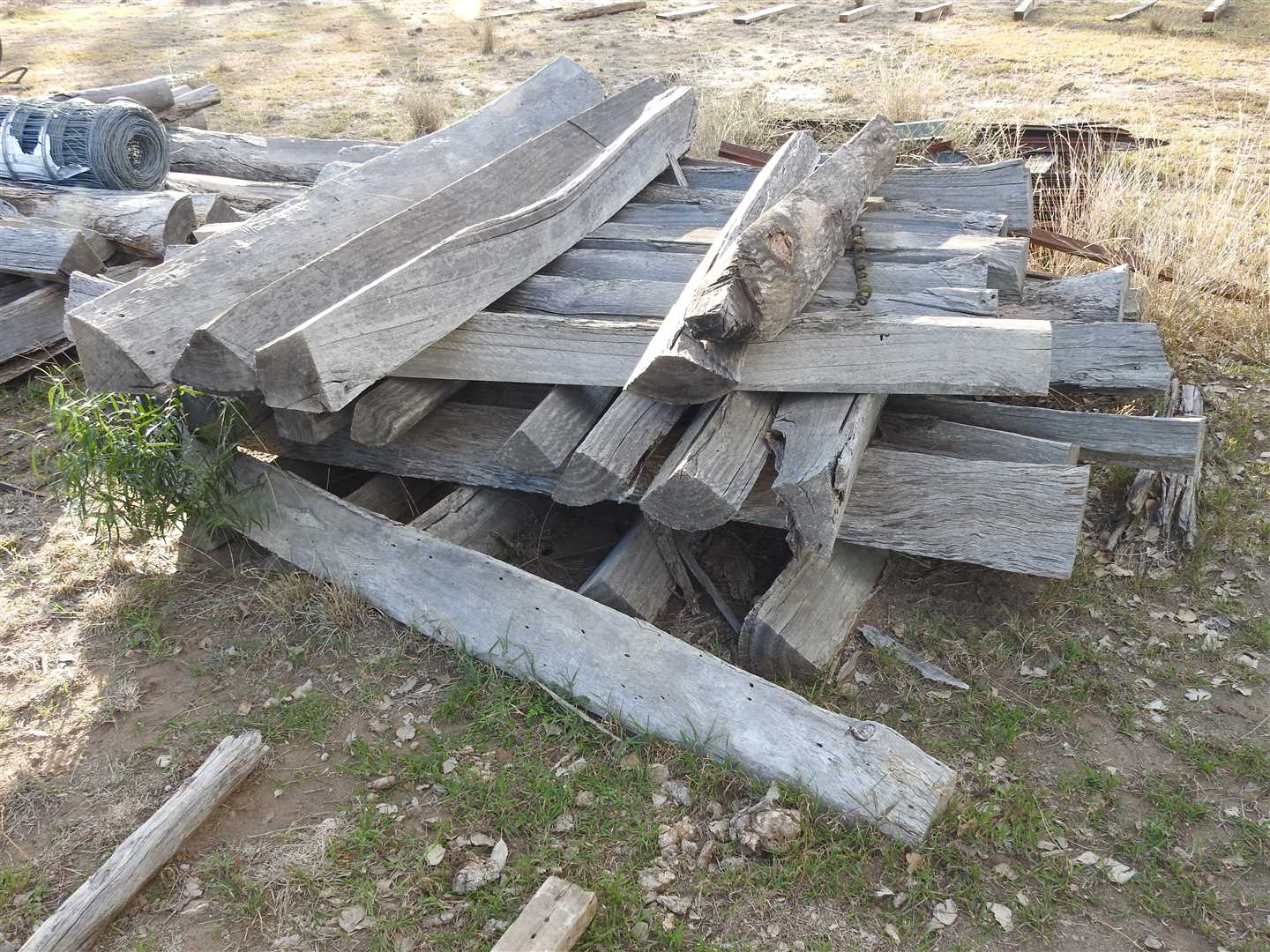 Qty of wooden posts- three piles