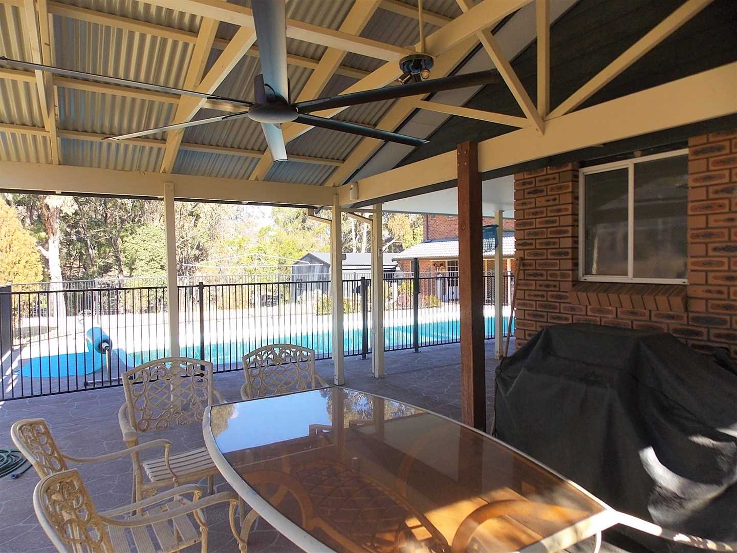 Outside dining area and pool