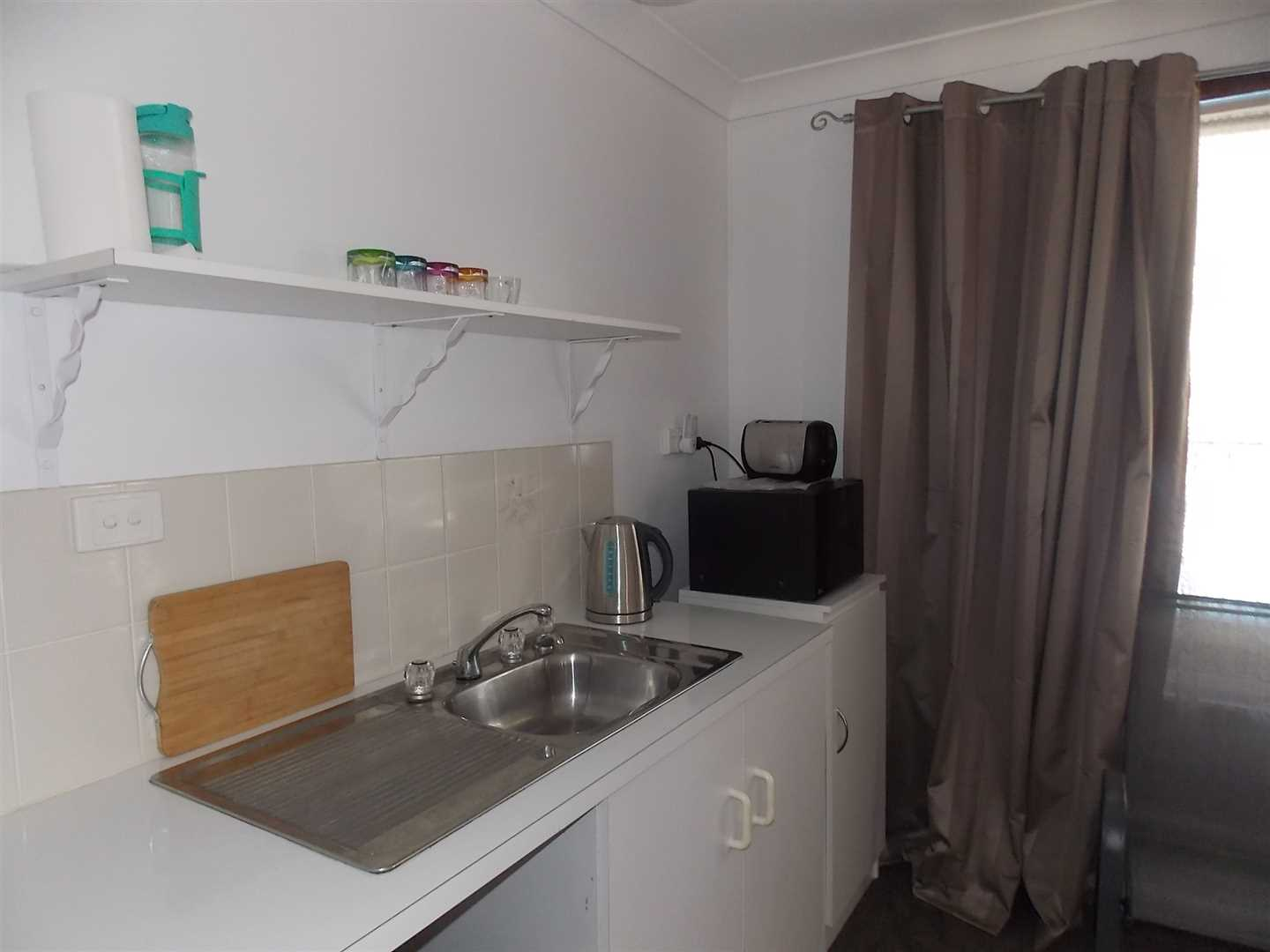 Kitchenette combined with kitchen and bedroom area