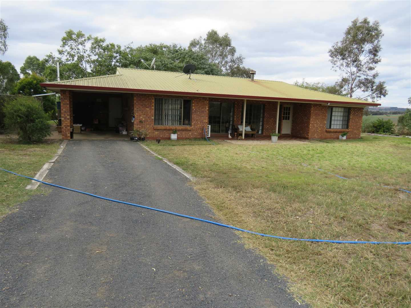Tidy 4 bed , single carport, brick veneer