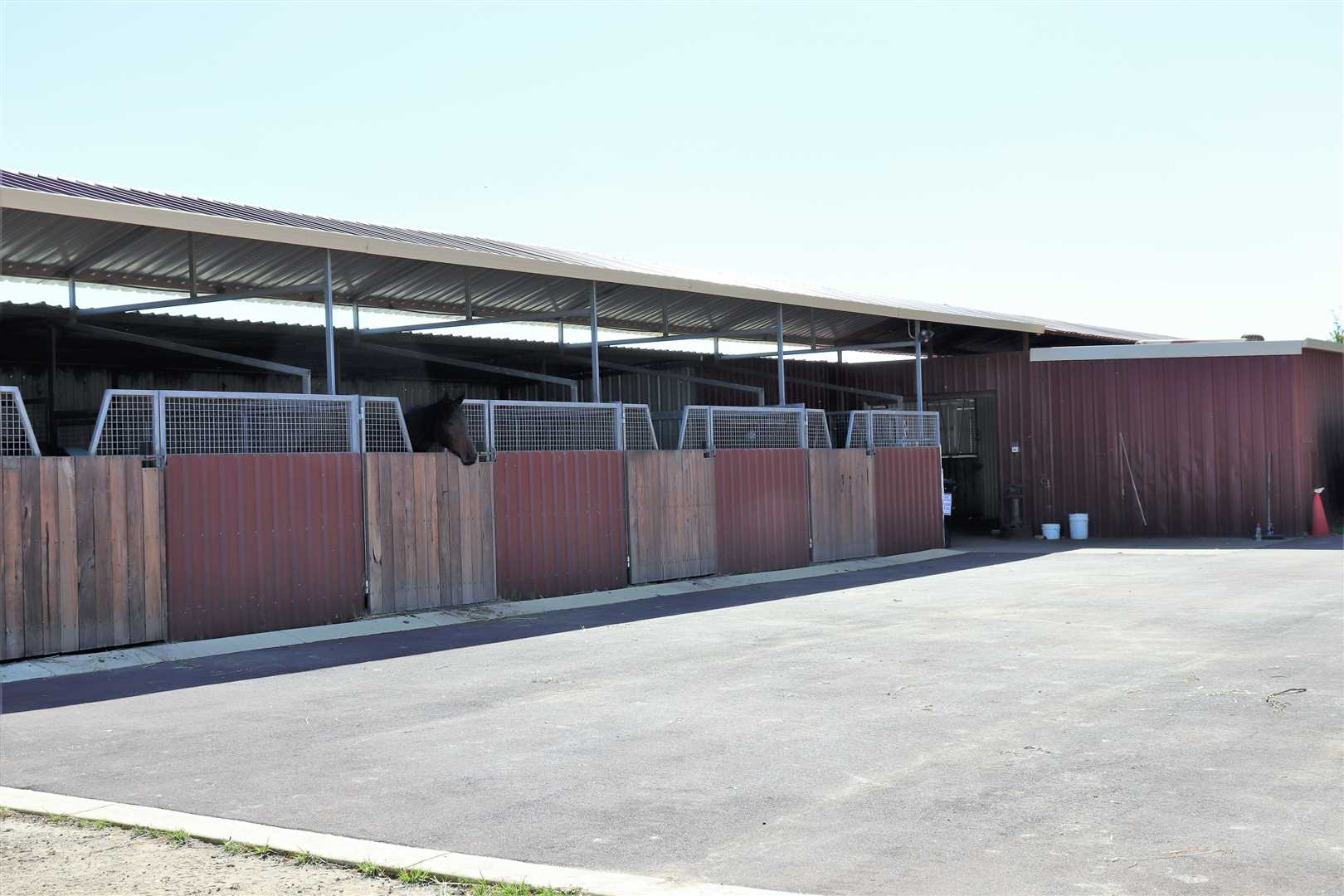 Stables and bitumen hardstand
