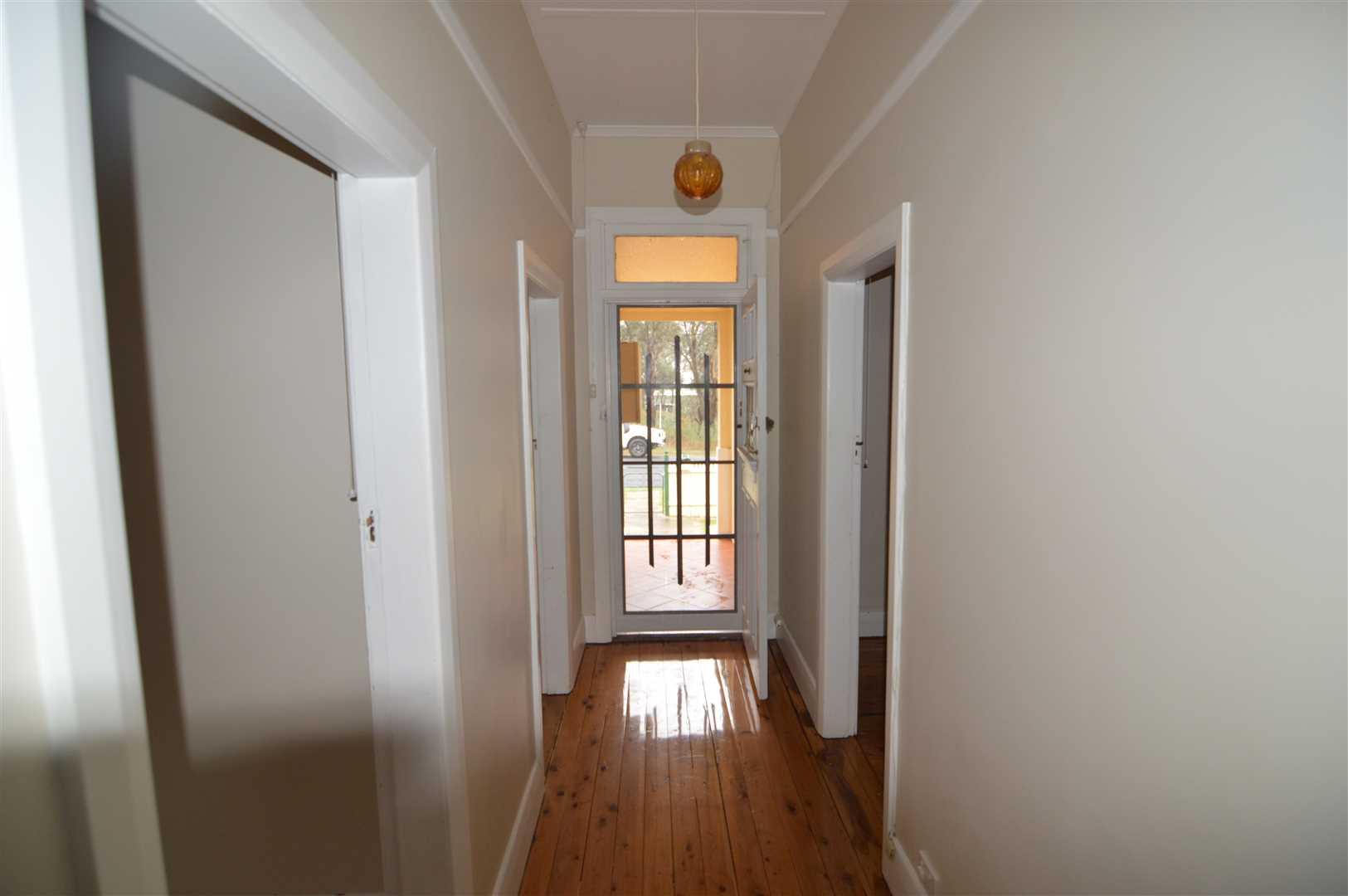 Hallway with polished floor boards