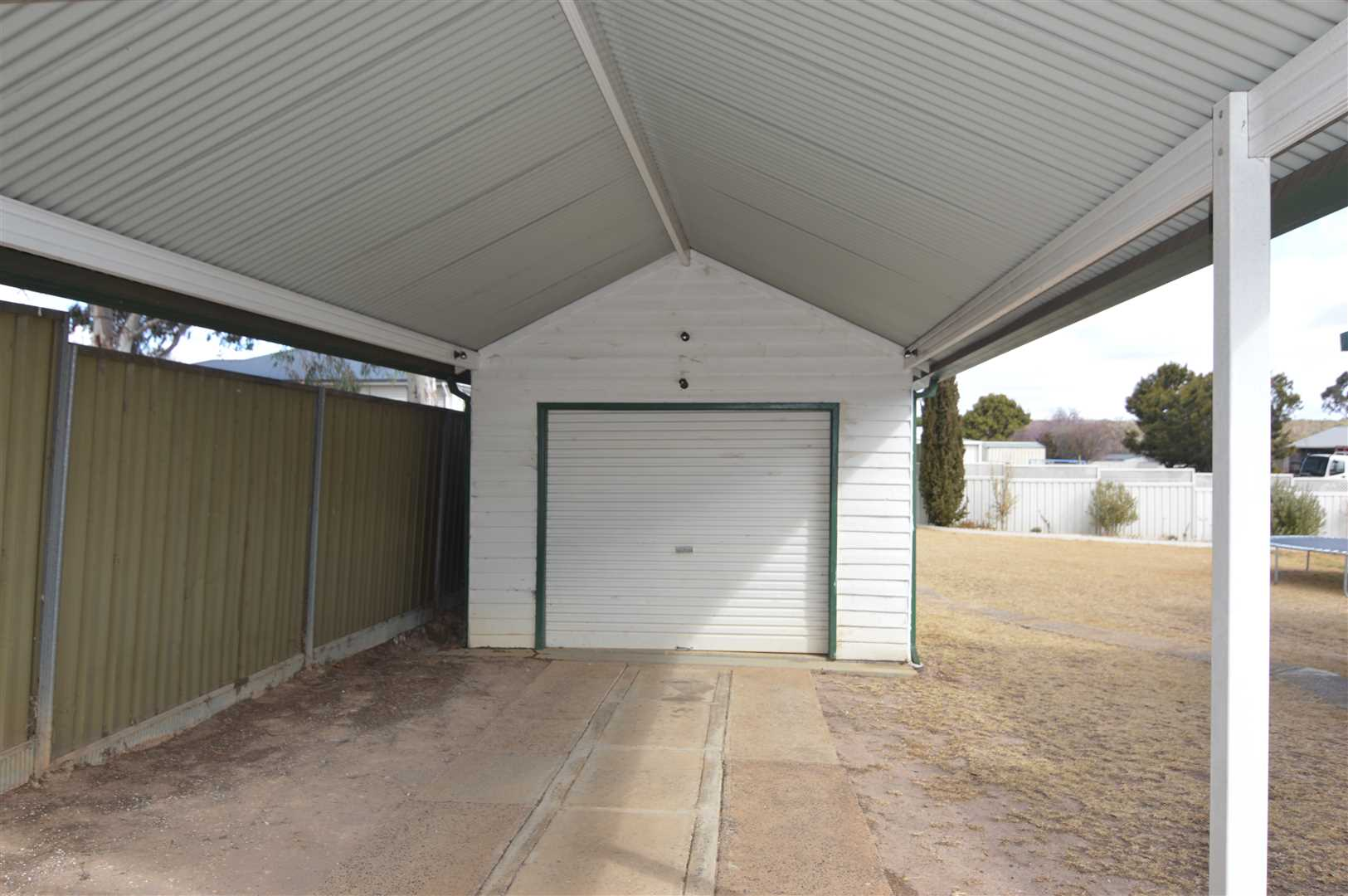 carport on the front of the three car garage