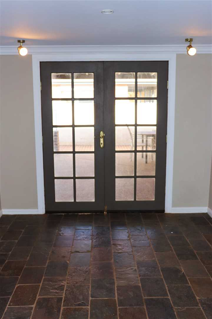 Beautiful french doors opening out to entertaining area.
