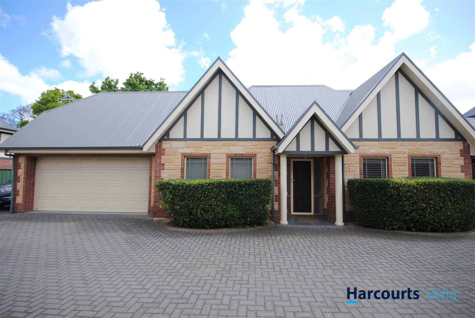 Free-standing Tudor Style 4 Bedroom Courtyard Home!