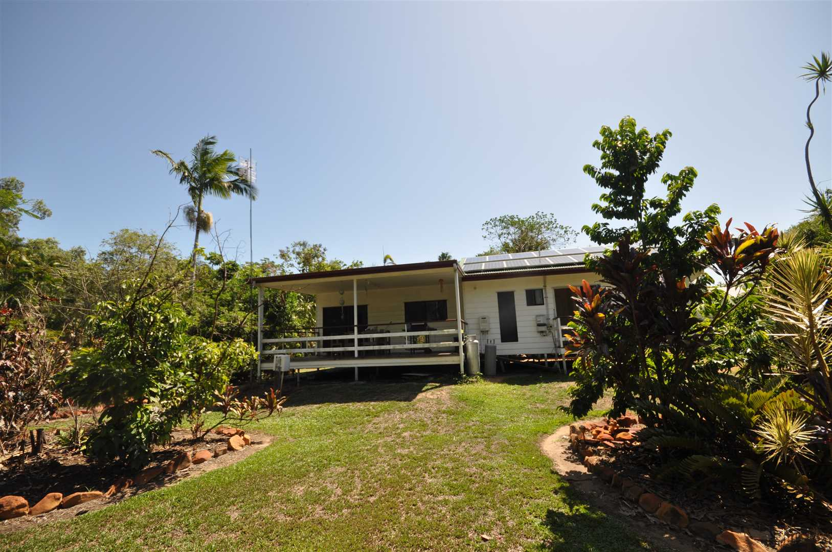 Privacy Assured on this tropical 2.5acres with modern home